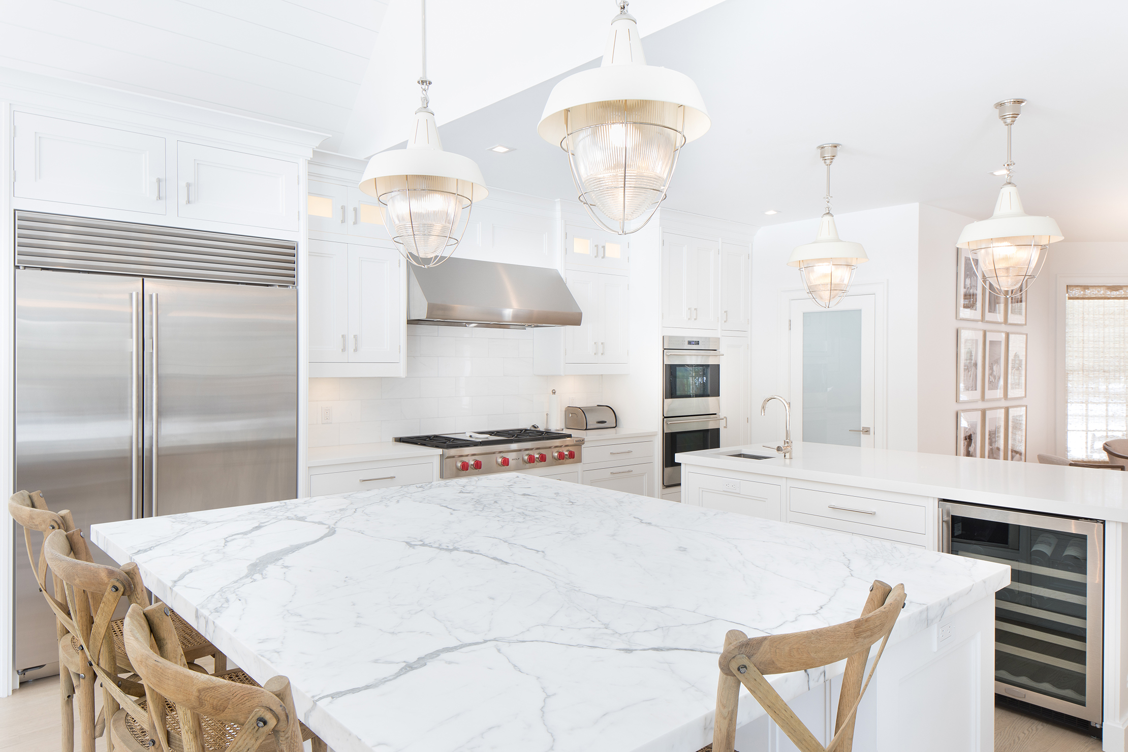 marble and quartz counters with white cabinets