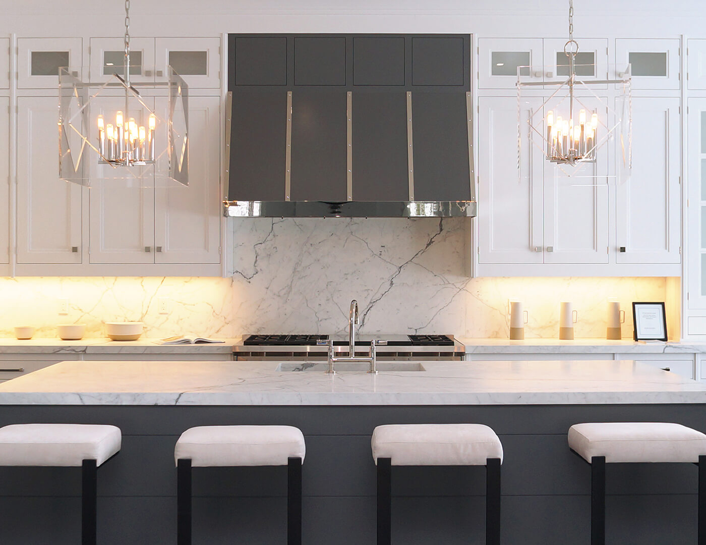 Bay Lane hand painted white and gray custom handcrafted cabinets with a microwave inset and custom wine chiller