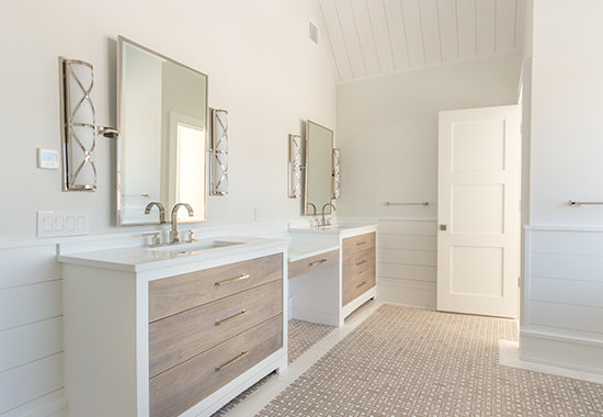 finished white frames allow the Cerused walnut fronts to be the focal point. Other features include polished nickel hardware and lowered vanity space.
