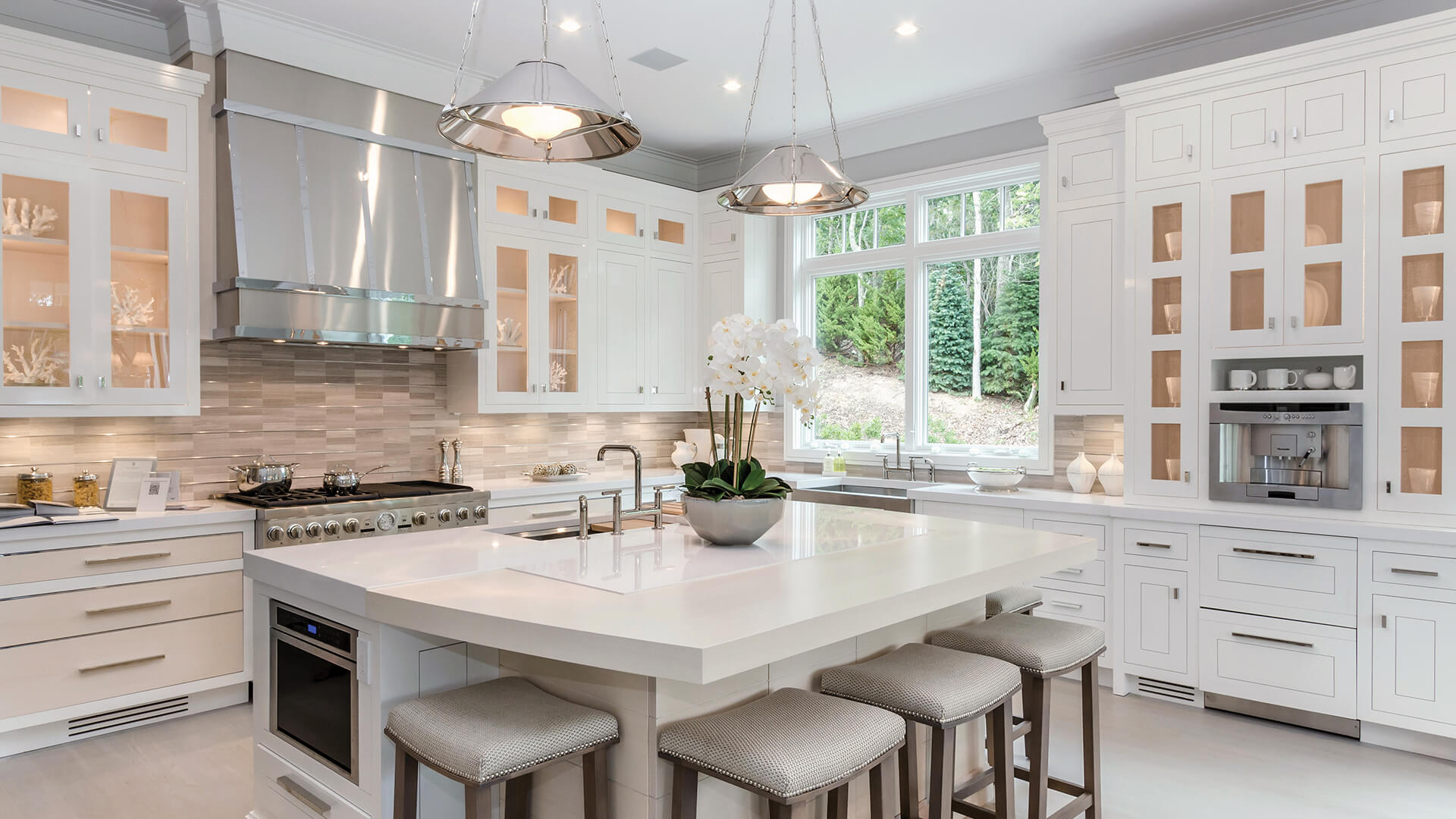 Hamptons Showhouse kitchen with hand-painted cabinets, inset appliances, and cream panels