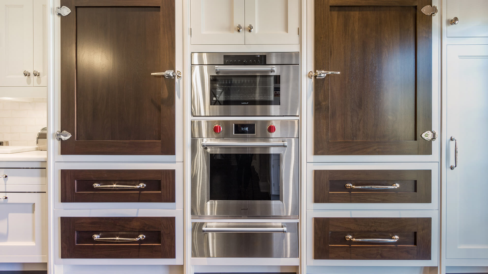 Dual refrigerator kitchen panels with inset stainless steal appliances
