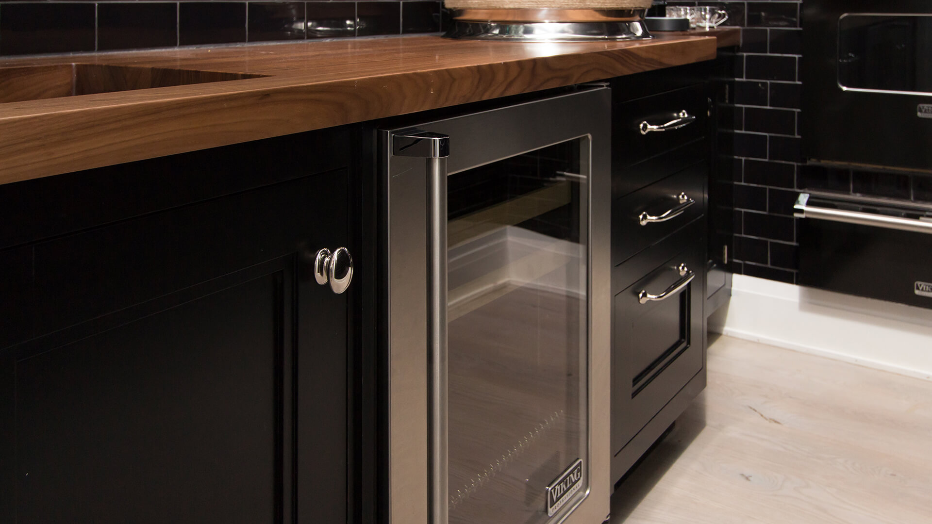 Bakes and Kropp Custom cabinetry with high gloss black cabinetry and custom wine chiller