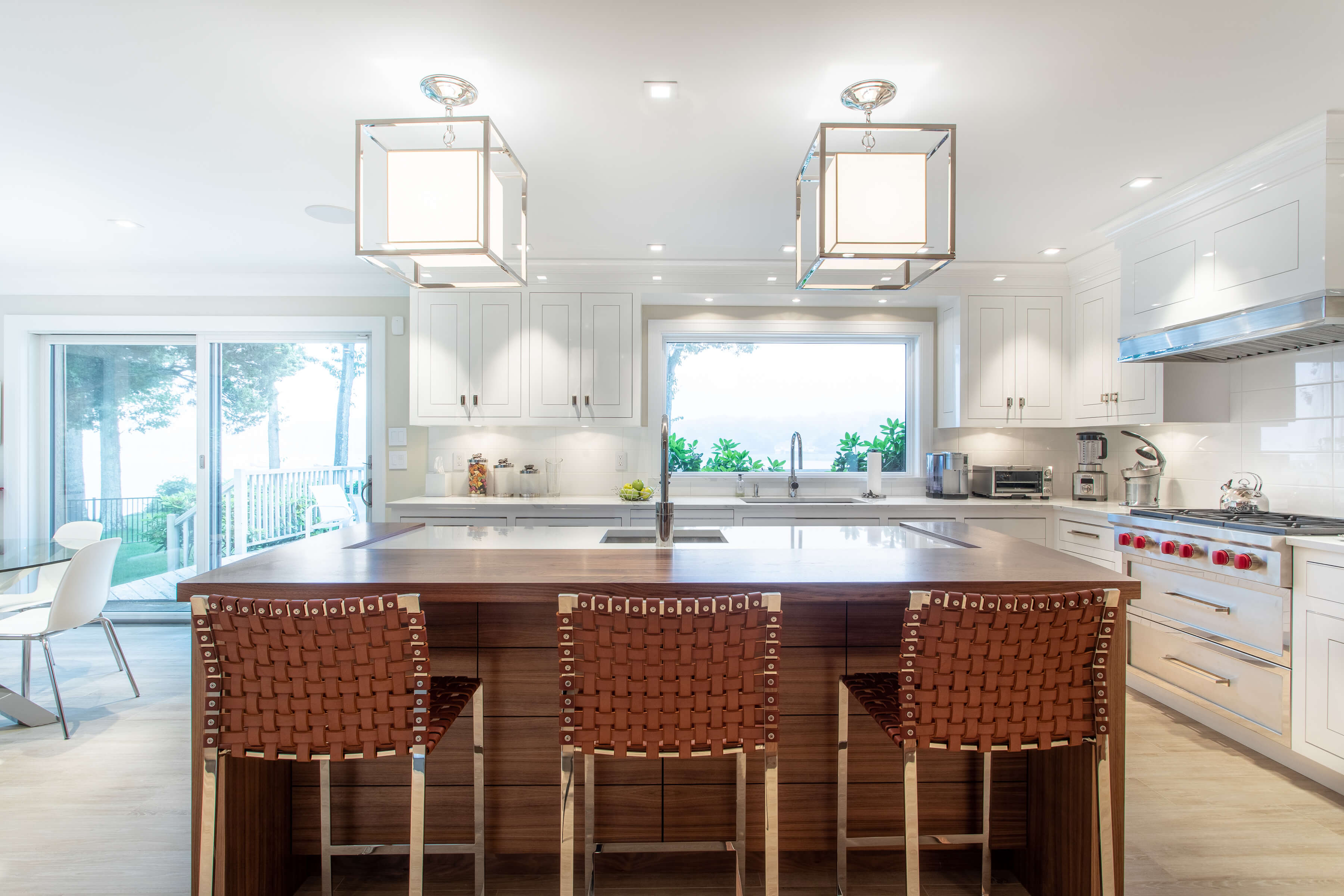 om Luxury Kitchen with Walnut and Maple Cabinets, (Revelane style cabinets) and Rift Walnut cabinets walnut kitchen island With Quartz White Counter Top fusion